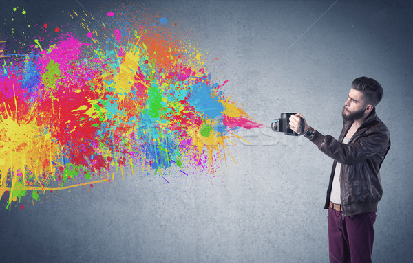 Hipster guy with camera and paint splash Stock photo © ra2studio