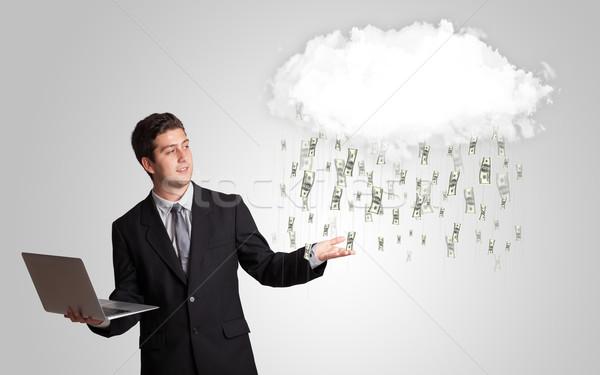 Man with cloud and money rain concept Stock photo © ra2studio