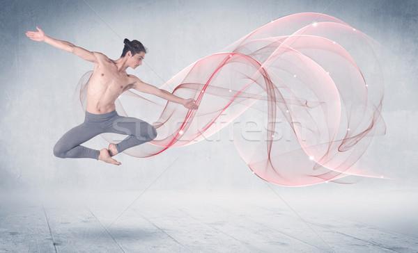 Dancing ballet performance artist with abstract swirl Stock photo © ra2studio