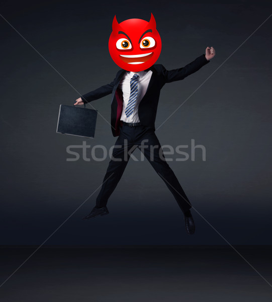 businessman wears devil smiley face Stock photo © ra2studio