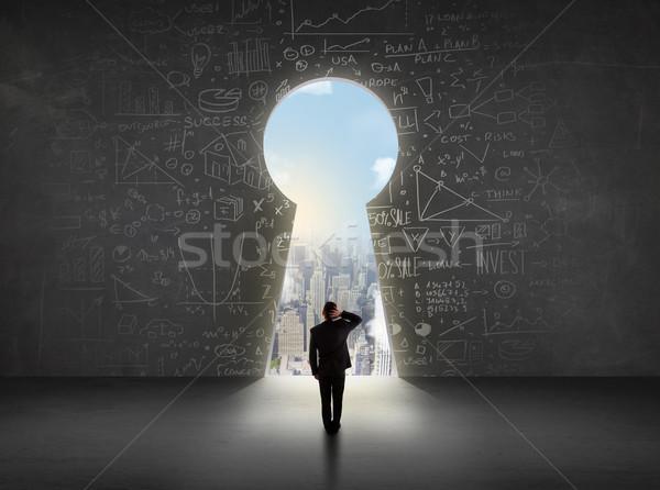 Homem de negócios olhando buraco de fechadura brilhante cityscape negócio Foto stock © ra2studio