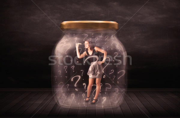 Businesswoman locked into a jar with question marks concept Stock photo © ra2studio