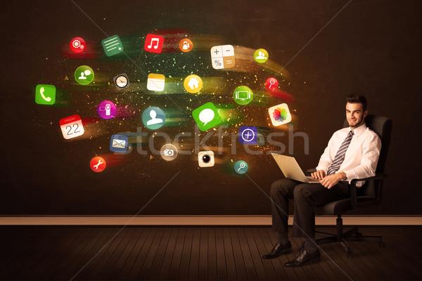 Iş adamı oturma ofis koltuğu dizüstü bilgisayar renkli uygulaması Stok fotoğraf © ra2studio