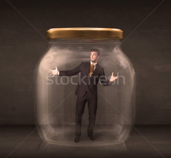 Stock photo: Businessman shut into a glass jar concept