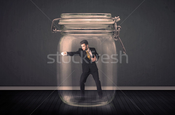 Om de afaceri prins sticlă borcan spaţiu finanţa Imagine de stoc © ra2studio