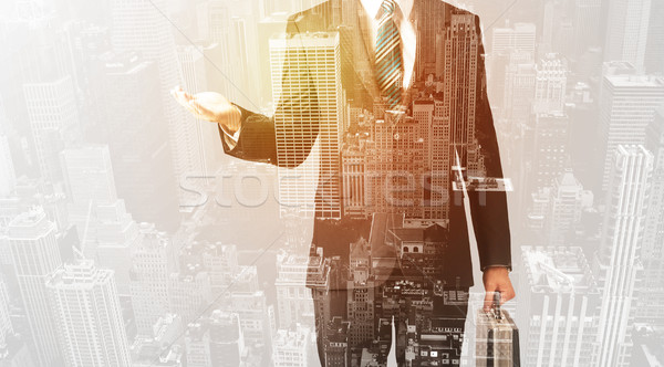 Business person with warm color overlay of city background Stock photo © ra2studio
