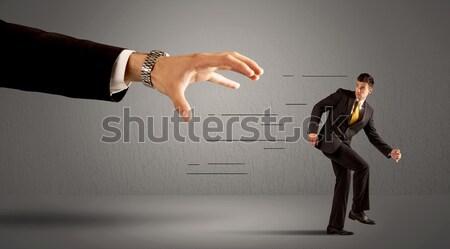 üzletember fut messze hatalmas kéz férfi Stock fotó © ra2studio