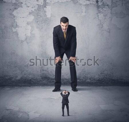 Nagy üzletember néz kicsi munkás munka Stock fotó © ra2studio