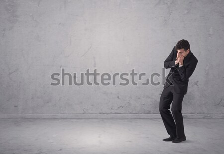 Stock photo: Young businessman standing confused