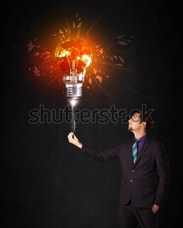 Zakenman explosie lamp zwarte macht informatie Stockfoto © ra2studio
