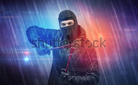 Poacher in mysterious rainy weather concept Stock photo © ra2studio