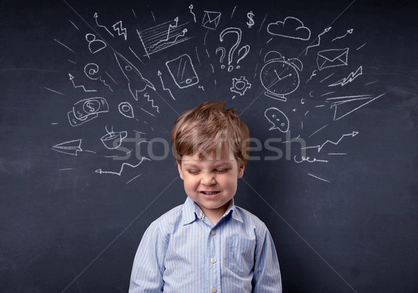 Little boy in front of a drawn up blackboard Stock photo © ra2studio