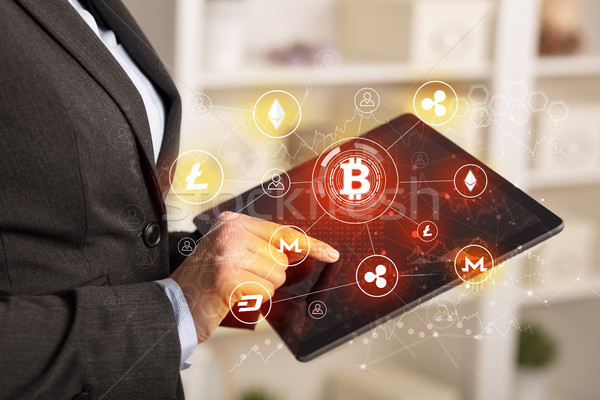 Business woman using tablet with bitcoin link network concept Stock photo © ra2studio