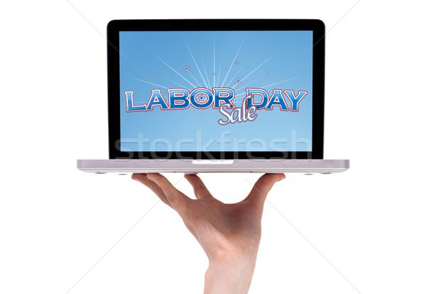 Férfi kéz tart laptop munka nap Stock fotó © ra2studio