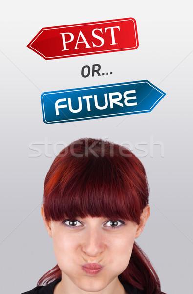Joven mirando positivo negativos signos cabeza Foto stock © ra2studio