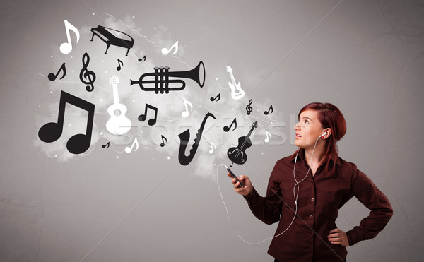 Beautiful young woman singing and listening to music with musical notes and instruments Stock photo © ra2studio