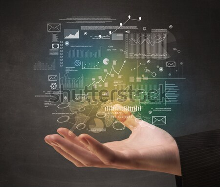 Woman drawing business scheme and icons on whiteboard Stock photo © ra2studio