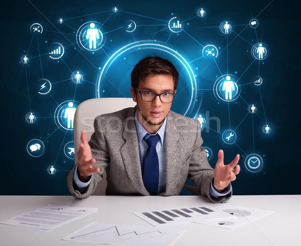 Сток-фото: бизнесмен · сидят · столе · иконки · молодые