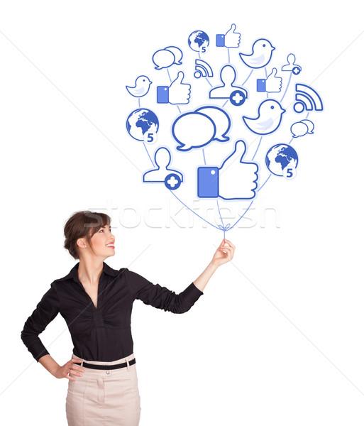 Stock photo: Happy lady holding social icon balloon