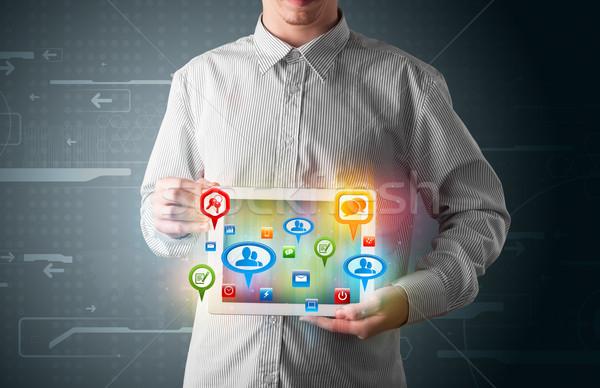 Fiatal üzletember bemutat modern tabletta színes Stock fotó © ra2studio