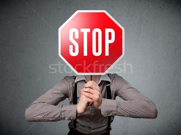 ビジネスマン 一時停止の標識 立って 頭 手 ストックフォト © ra2studio
