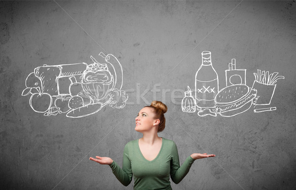 Woman standing between healthy and unhealthy foods Stock photo © ra2studio