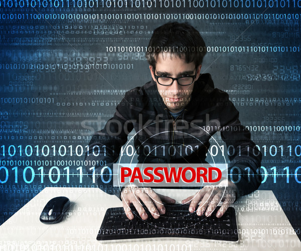 Stock photo: Young geek hacker stealing password
