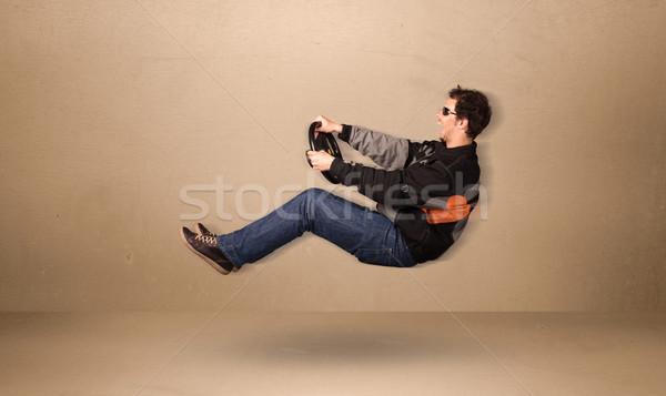 Felice divertente uomo guida battenti auto Foto d'archivio © ra2studio