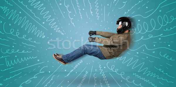 Funny guy drives an imaginary vehicle with drawn lines around hi Stock photo © ra2studio