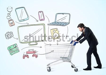 Empresario cesta de la compra empujando los medios de comunicación Foto stock © ra2studio