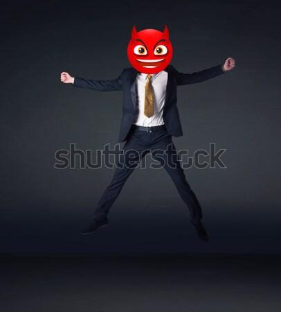 Stock fotó: üzletember · ördög · mosolygós · arc · vicces · üzlet · férfi