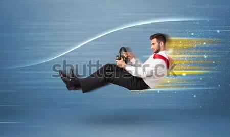 Jeune homme conduite imaginaire rapide voiture floue Photo stock © ra2studio