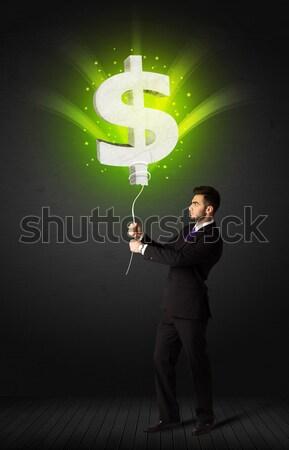 бизнесмен знак доллара шаре зеленый Сток-фото © ra2studio