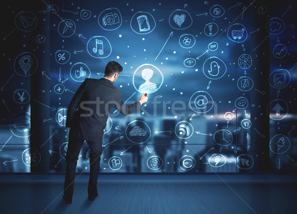 Businessman drawing social media connection scheme Stock photo © ra2studio