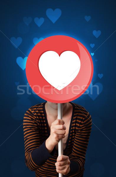 Woman holding heart sign Stock photo © ra2studio
