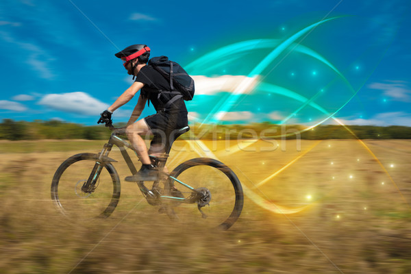 Magical young cyclist riding Stock photo © ra2studio