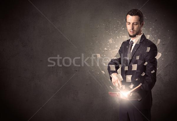 Stock photo: Man reading book.