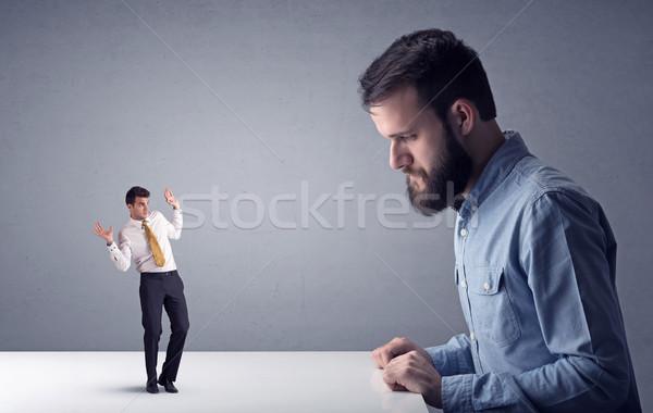 молодые бизнесмен миниатюрный профессиональных сердиться Сток-фото © ra2studio