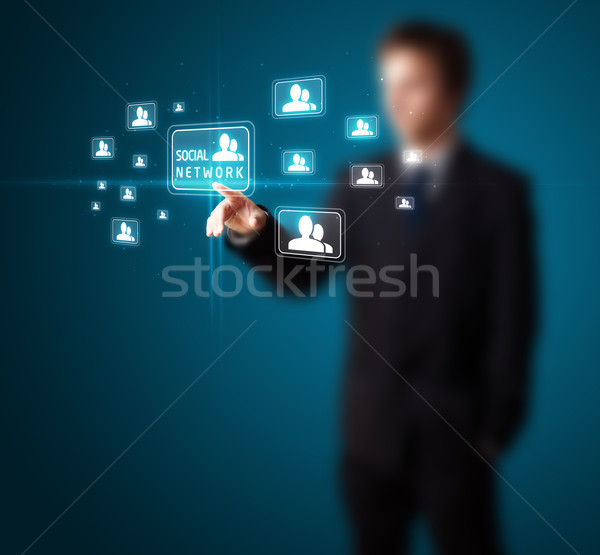 Stock photo: Businessman pressing modern social type of icons