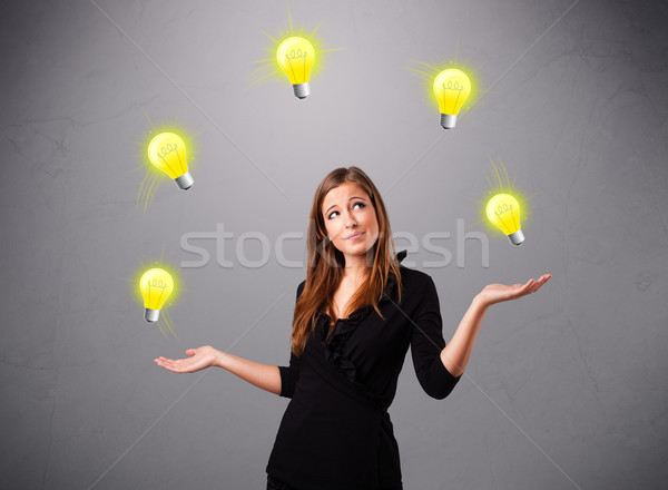 Jonge dame permanente jongleren mooie Stockfoto © ra2studio