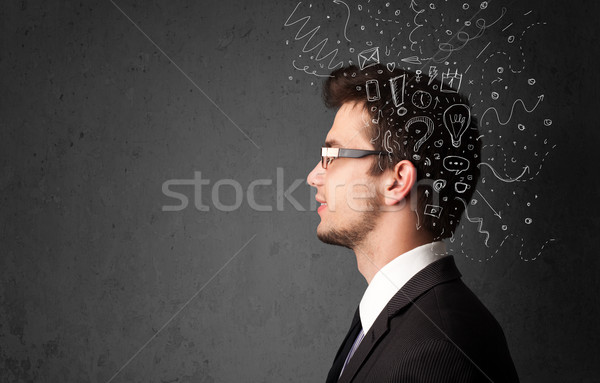 Young man thinking with abstract lines and symbols Stock photo © ra2studio