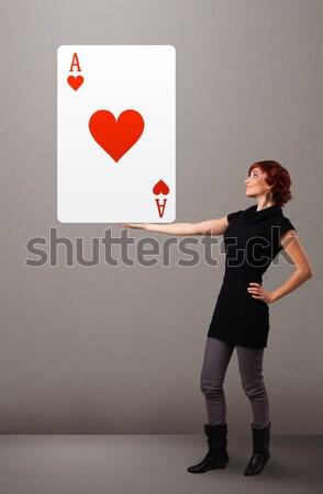 Gyönyörű nő tart piros szív ász gyönyörű Stock fotó © ra2studio