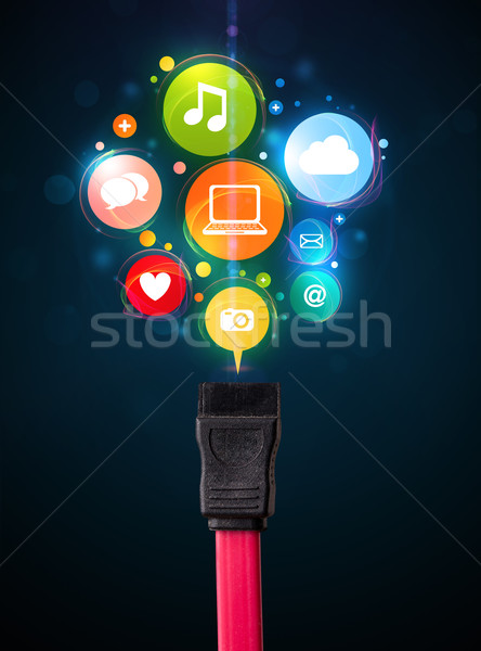 Social media icons coming out of electric cable Stock photo © ra2studio