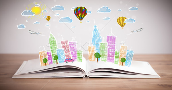 cityscape drawing on open book Stock photo © ra2studio