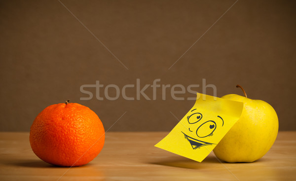 Stock photo: Apple with post-it note looking curiously at orange