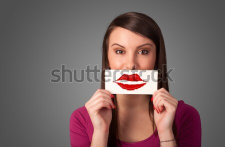 Happy cute girl holding paper with mustache drawing  Stock photo © ra2studio