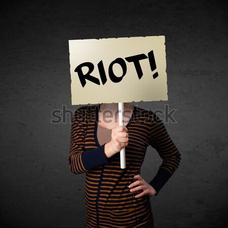Genç kadın protesto imzalamak gösteri tahta Stok fotoğraf © ra2studio