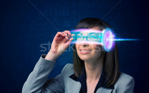 Stock photo: Woman from future with high tech smartphone glasses