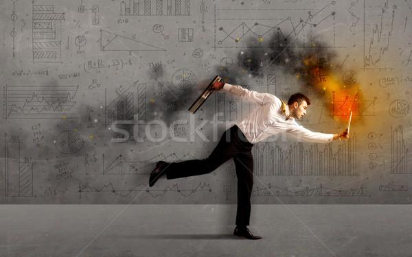Fut üzletember tűz laptop sietség üzlet Stock fotó © ra2studio