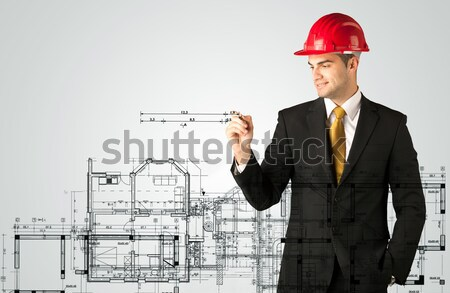 An young architect drawing a house plan Stock photo © ra2studio